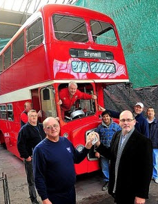 Gleision cheque handover at Swansea Bus Museum